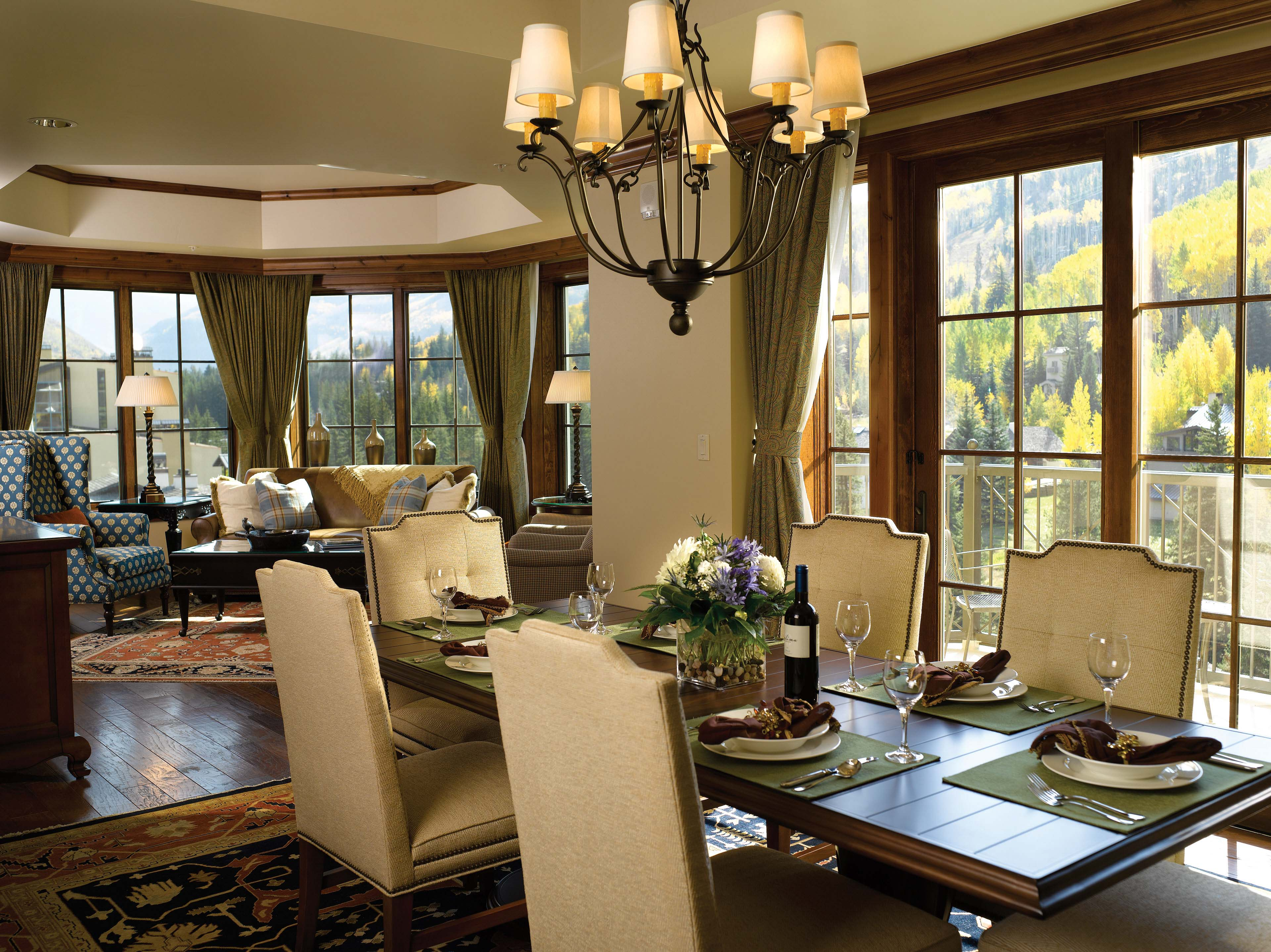 View of a dining table inside of a luxury private residence.
