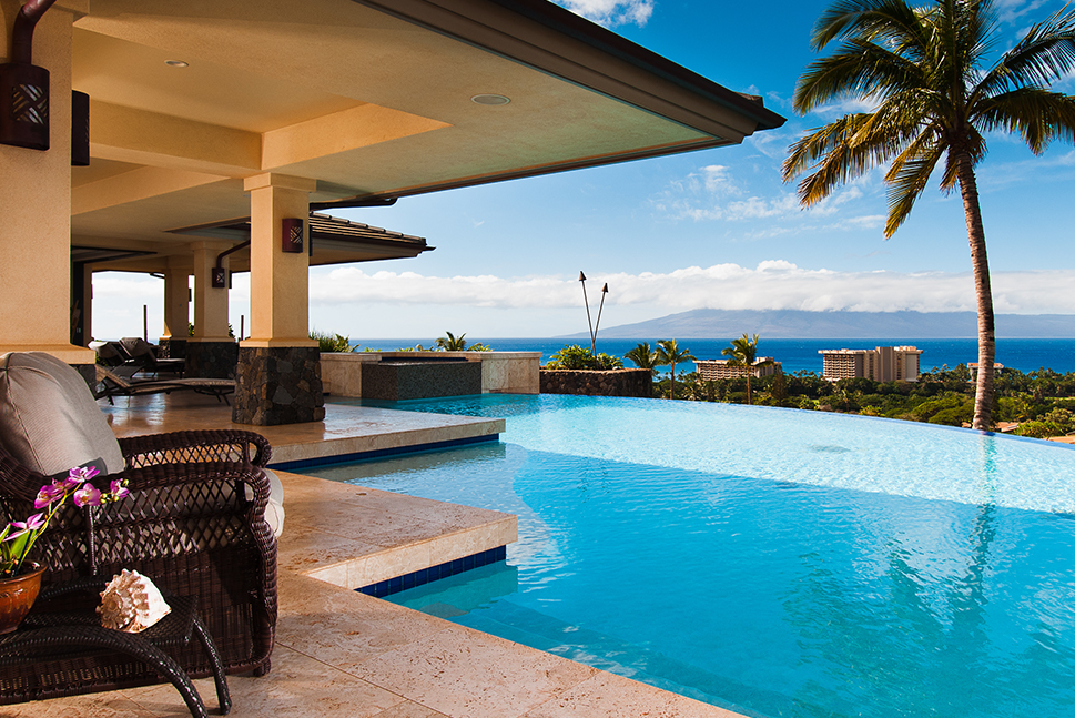 A magnificent pool view at a luxury vacation home overlooking the ocean. Over 2,000 vacation homes at your fingertips.